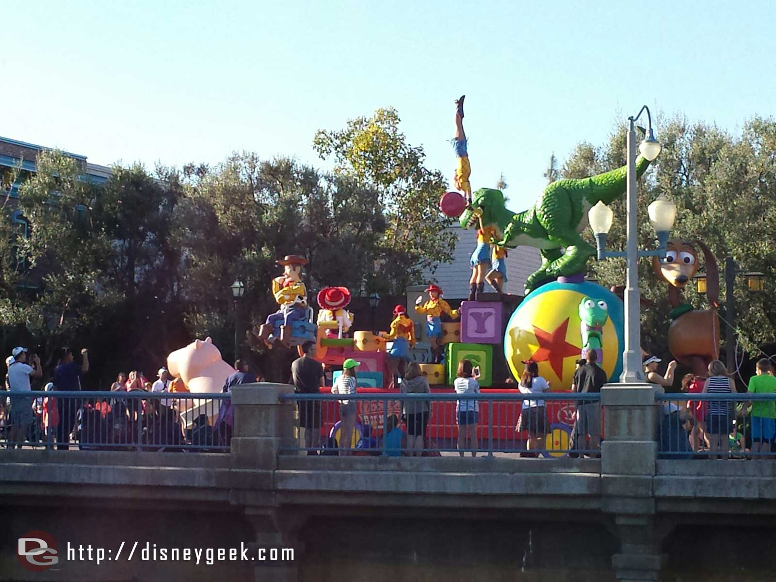The Pixar Play Parade passing by the Wharf area
