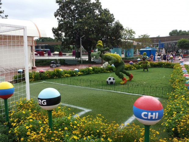 Goofy and Donald Topiaries playing soccer - Epcot
