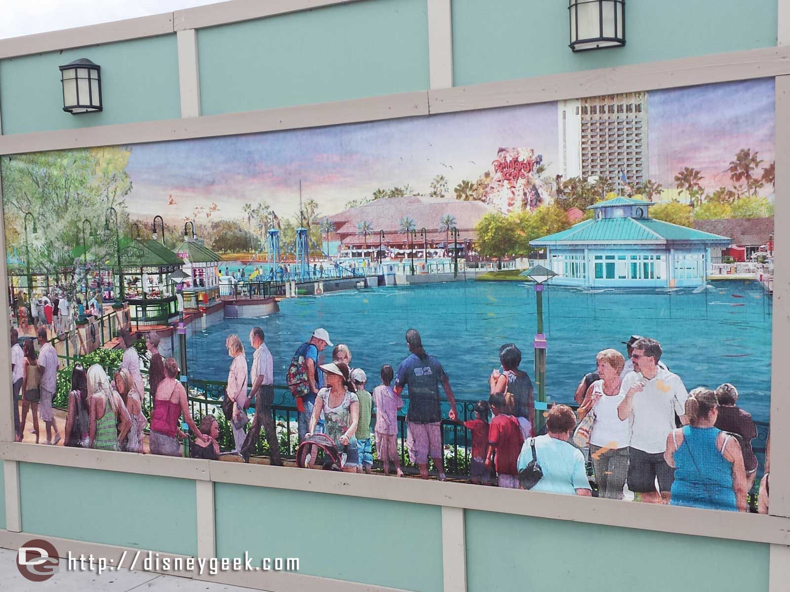 Disney Springs concept art on one of the walls showing what is coming.