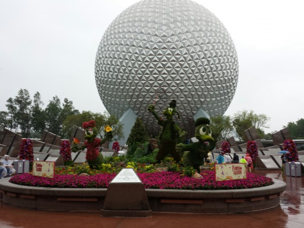 The entrance topiary display at the Epcot International Flower & Garden Festival features Donald, Daisy, and Goofy.