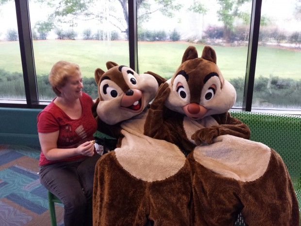 As we talked and watched the rain Chip and Dale paid us a visit.  Here they are with Deb Koma from AllEars.net, they took my seat.