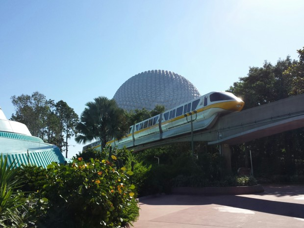 Monorail Yellow passing overhead with Spaceship Earth in the Background