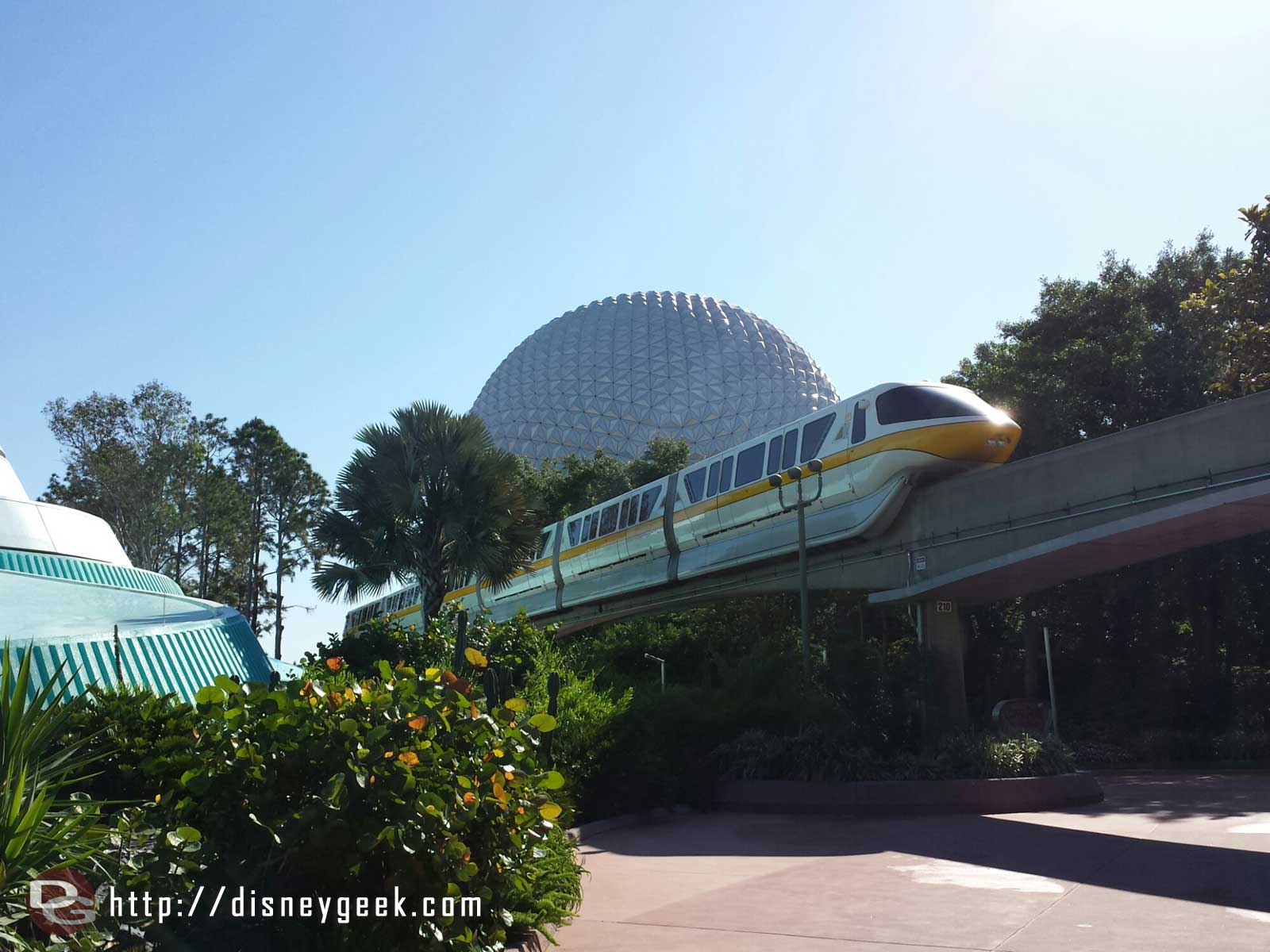 Monorail yellow passing by Spaceship Earth #Epcot