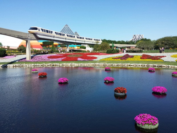 Monorail passing over the floating baskets and large flower beds of Future World - Epcot International Flower & Garden Festival