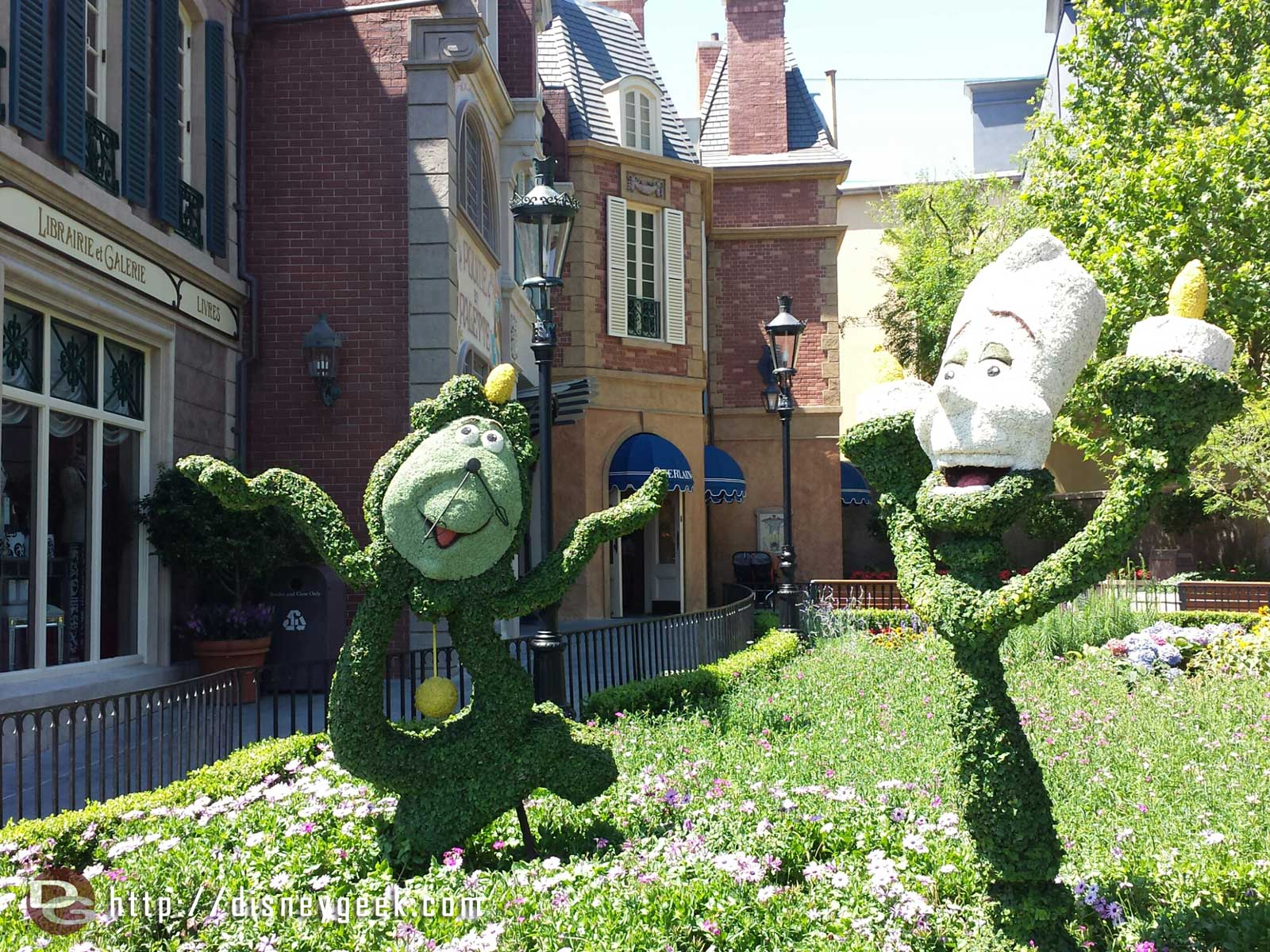 Cogsworth & Lumiere topiaries in France –  Epcot International Flower & Garden Festival
