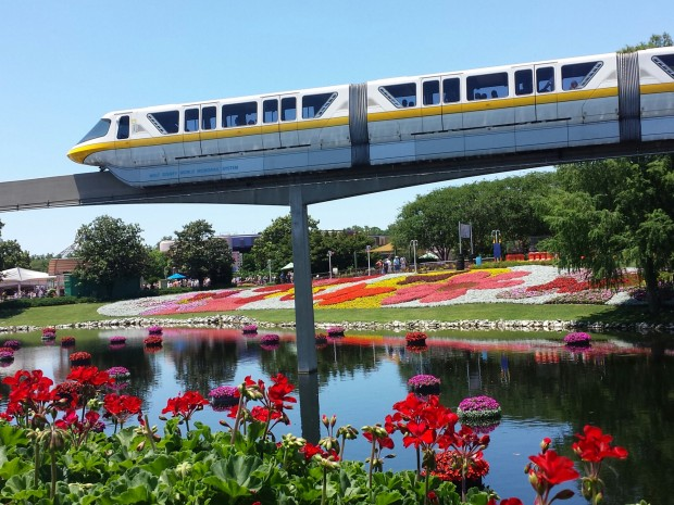Monorail Yellow passng by the flower beds - Epcot International Flower & Garden Festival