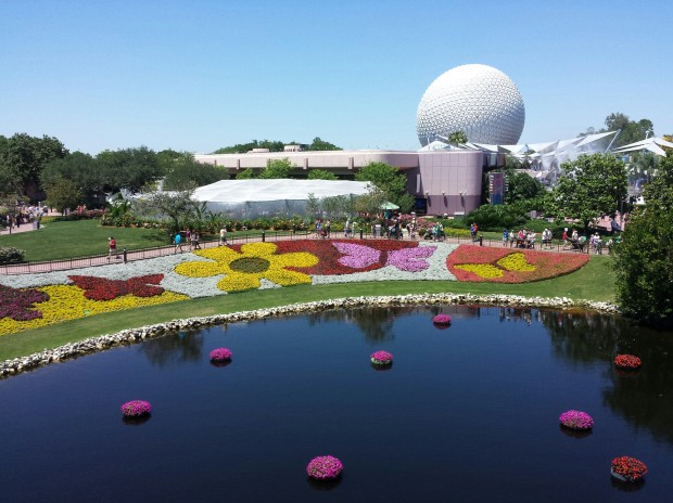The view from onboard the Monorail of the flower beds with Spaceship Earth in the background - Epcot International Flower & Garden Festival