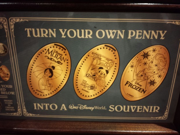 The pressed pennies at the International Gateway - Elsa, Mulan, and China