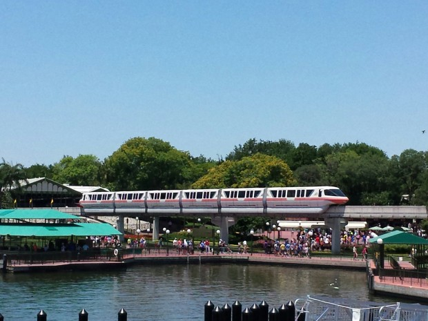 A monorail pulling out of the Magic Kingdom station.