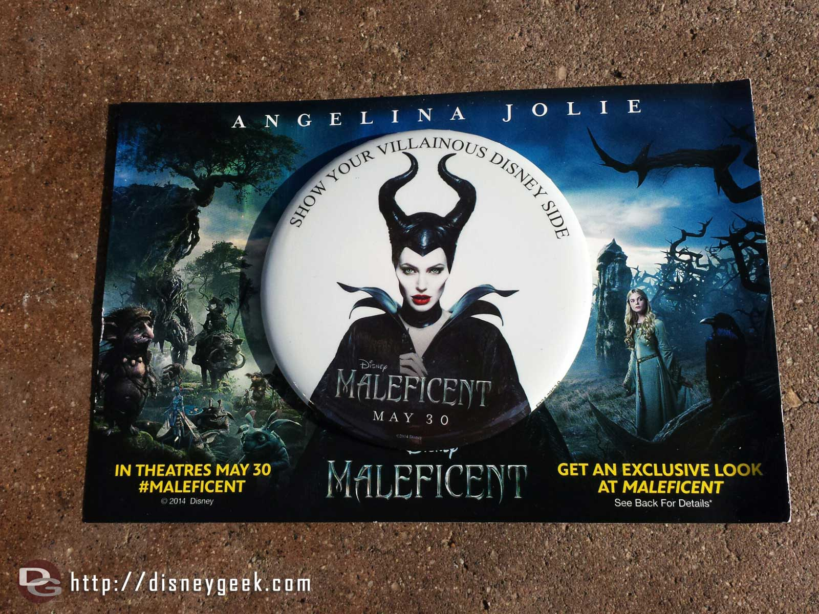 Maleficent buttons and card are being passed out as you enter today #Disney24  #DisneySide