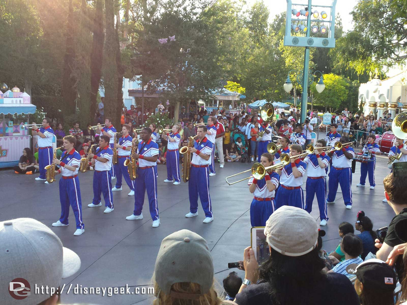2014 #Disneyland All American College Band Disney movie medley being performed near small world at their final stop
