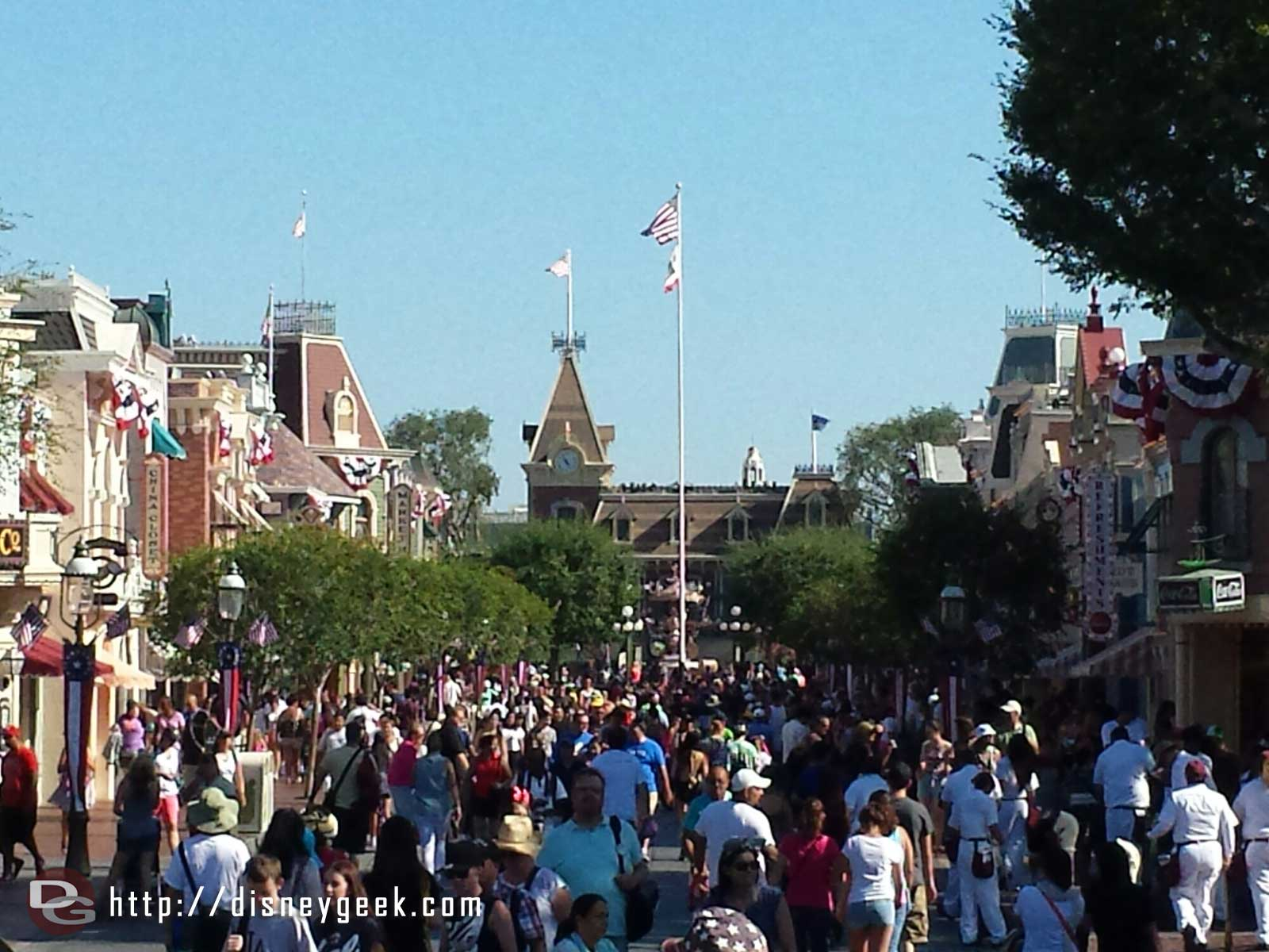 A look down Main Street USA, in the distance the final Soundsational float is just passing through Town Square
