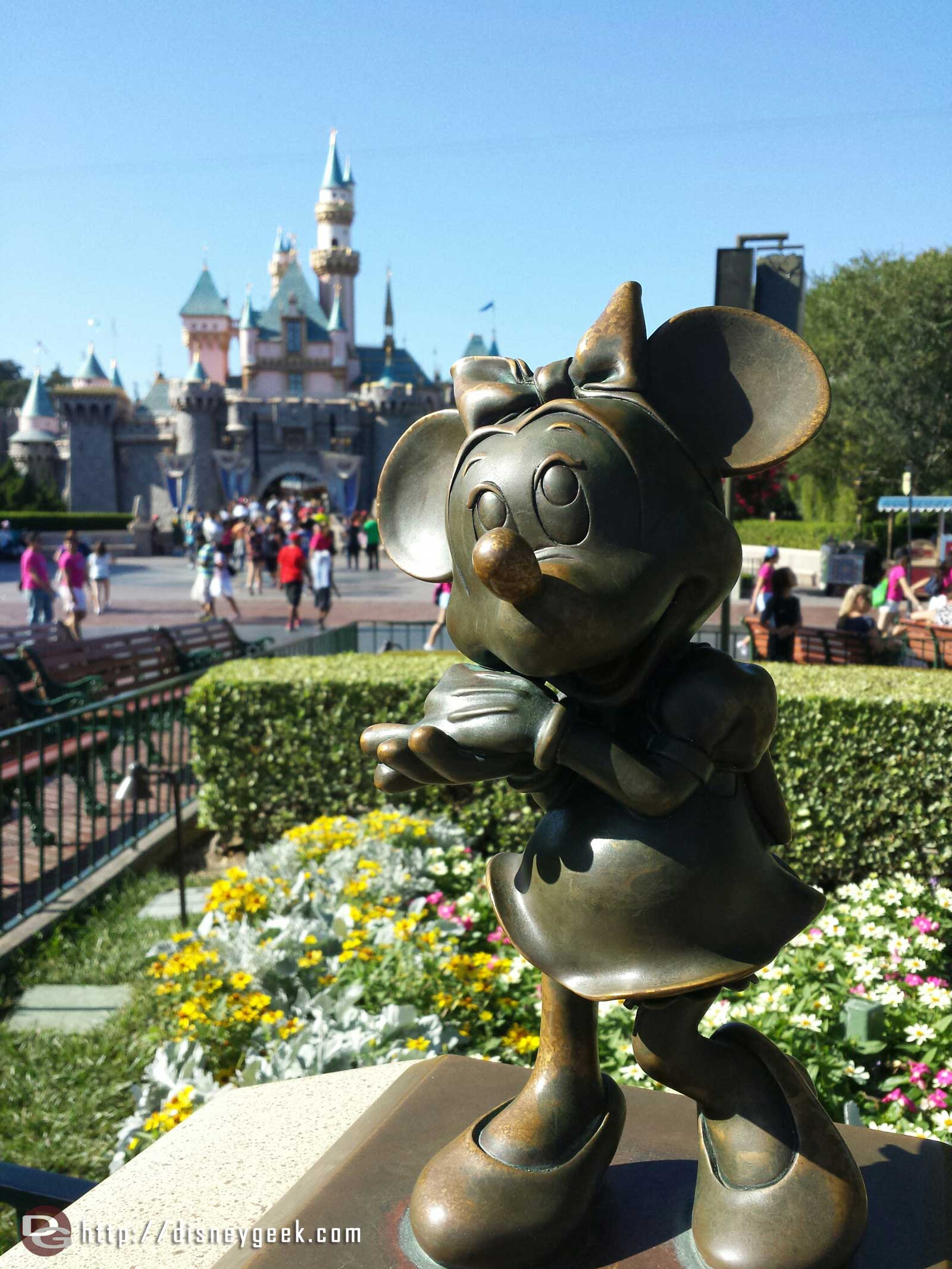 Minnie statue and Sleeping Beauty Castle