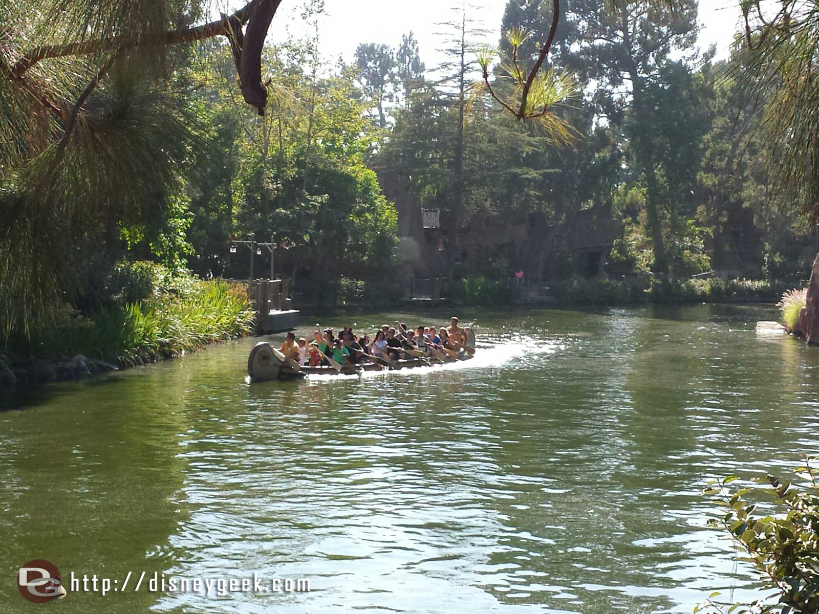 A canoe passing by on the Rivers of America