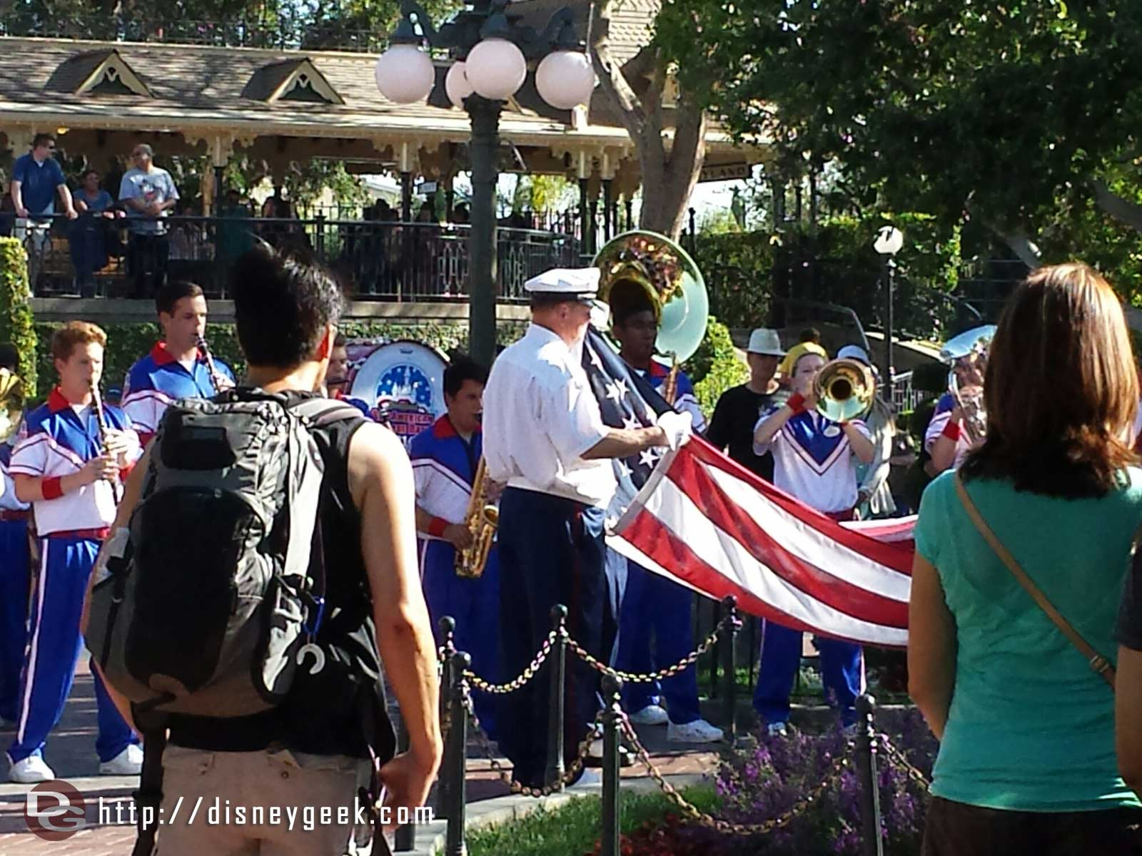 Folding the US Flag at the nightly Flag Retreat Ceremony in Town Square #Disneyland