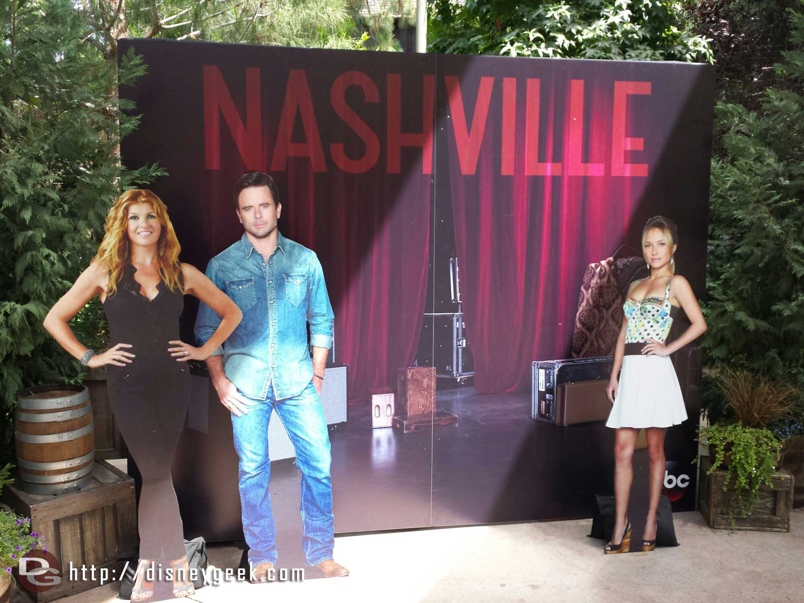 A photo op with cut outs of the Nashville cast