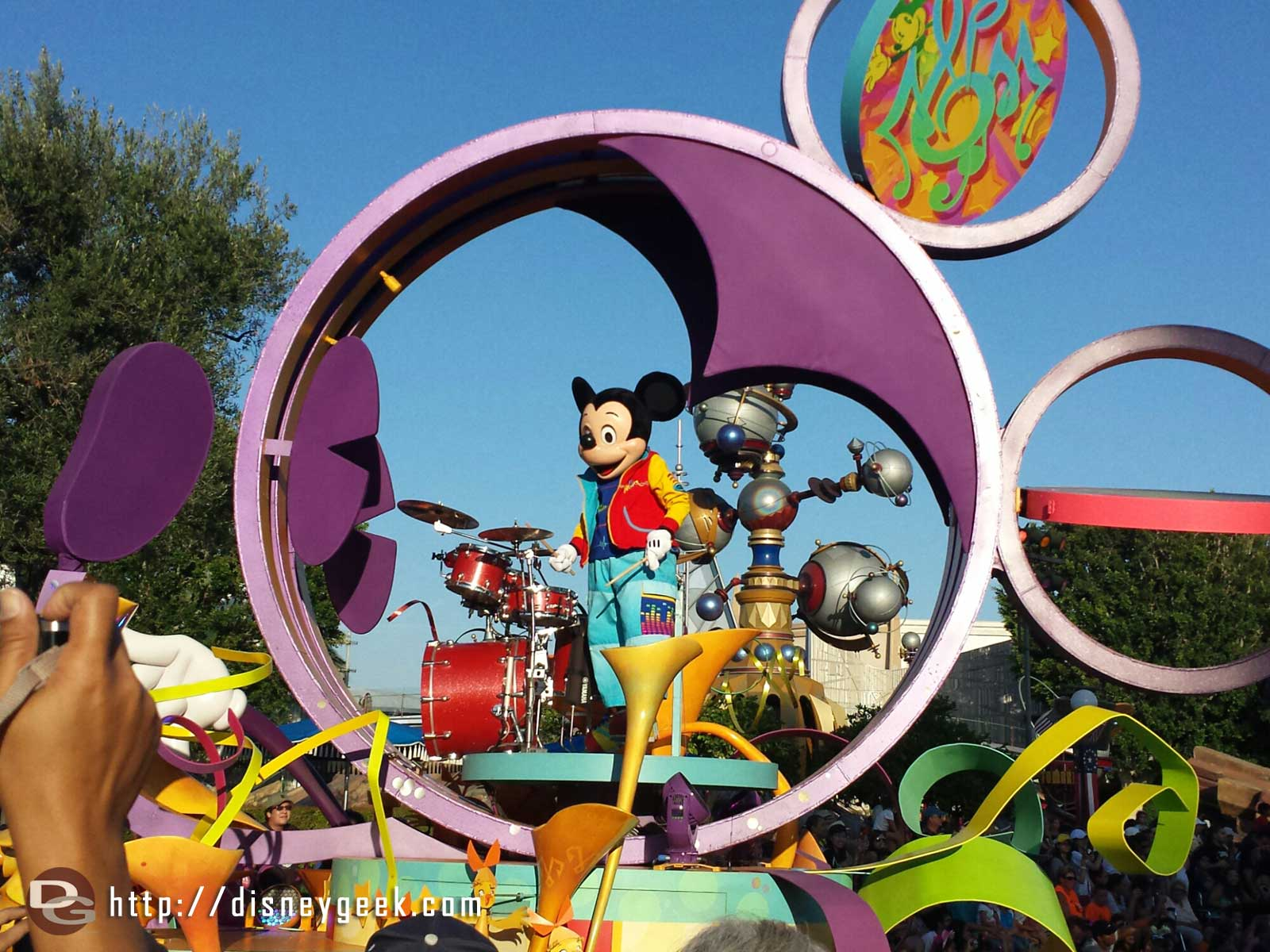 Mickey in Soundsational passing by Tomorrowland #Disneyland