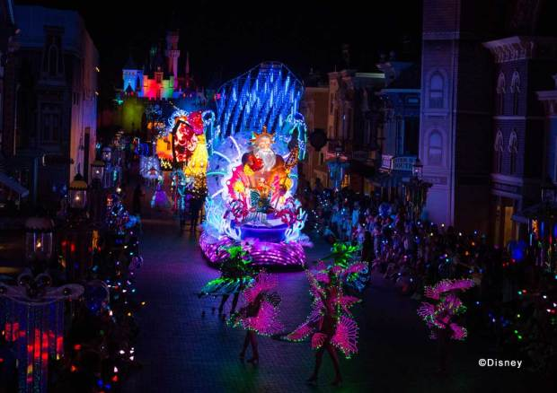 """Disney Paint the Night"" The Little Mermaid Unit Life under the sea is an underwater, watercolor wonderland of vibrant, glowing hues! King Triton, Ariel and a school of glowing ""sea creatures"" fill the streets with their own briny brilliance."