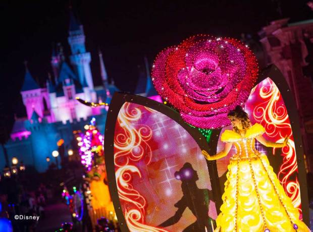 """Disney Paint the Night"" Belle Candlelight Unit Vibrant projections that depict memorable and iconic moments from Belle's ""tale as old as time"" story fill her gown and travel upwards onto a giant tapestry of electric imagery, featuring unforgettable chapters from her beloved story."
