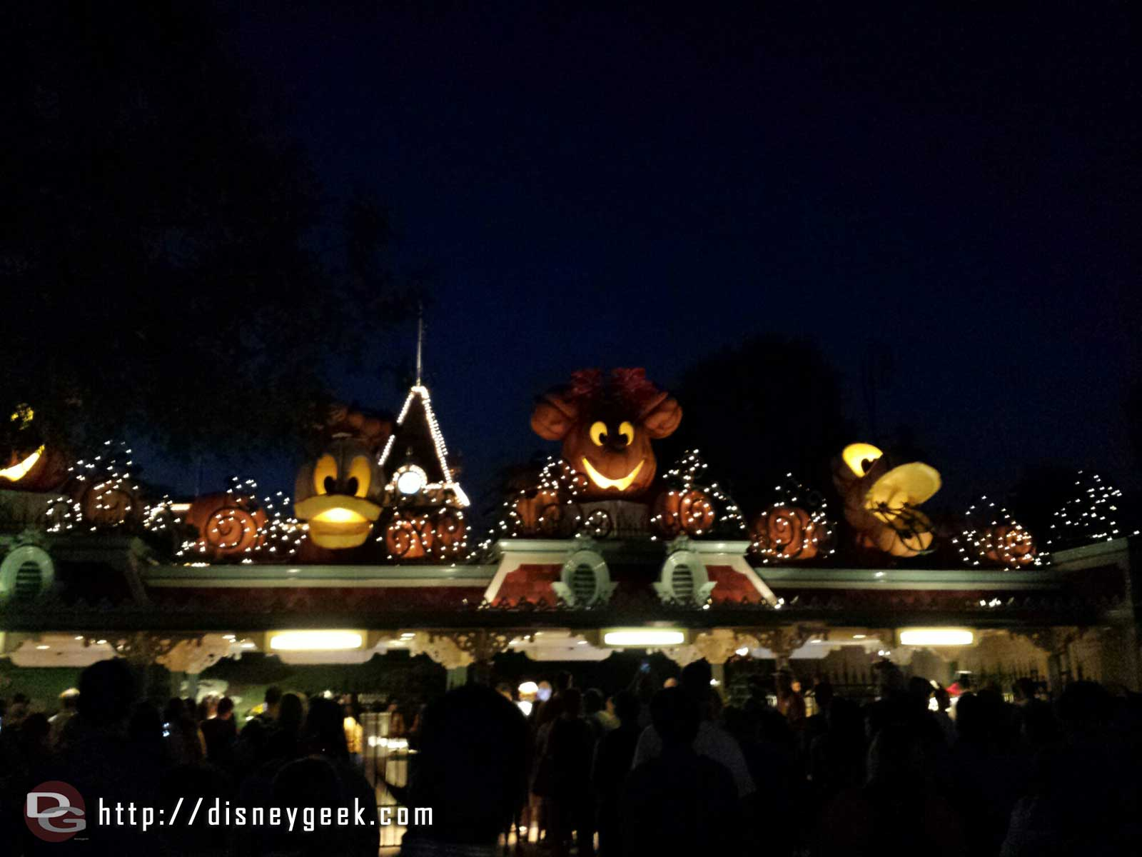#Disneyland entrance – pumpkin characters lit up,  the lines stretched past the Monorail beam