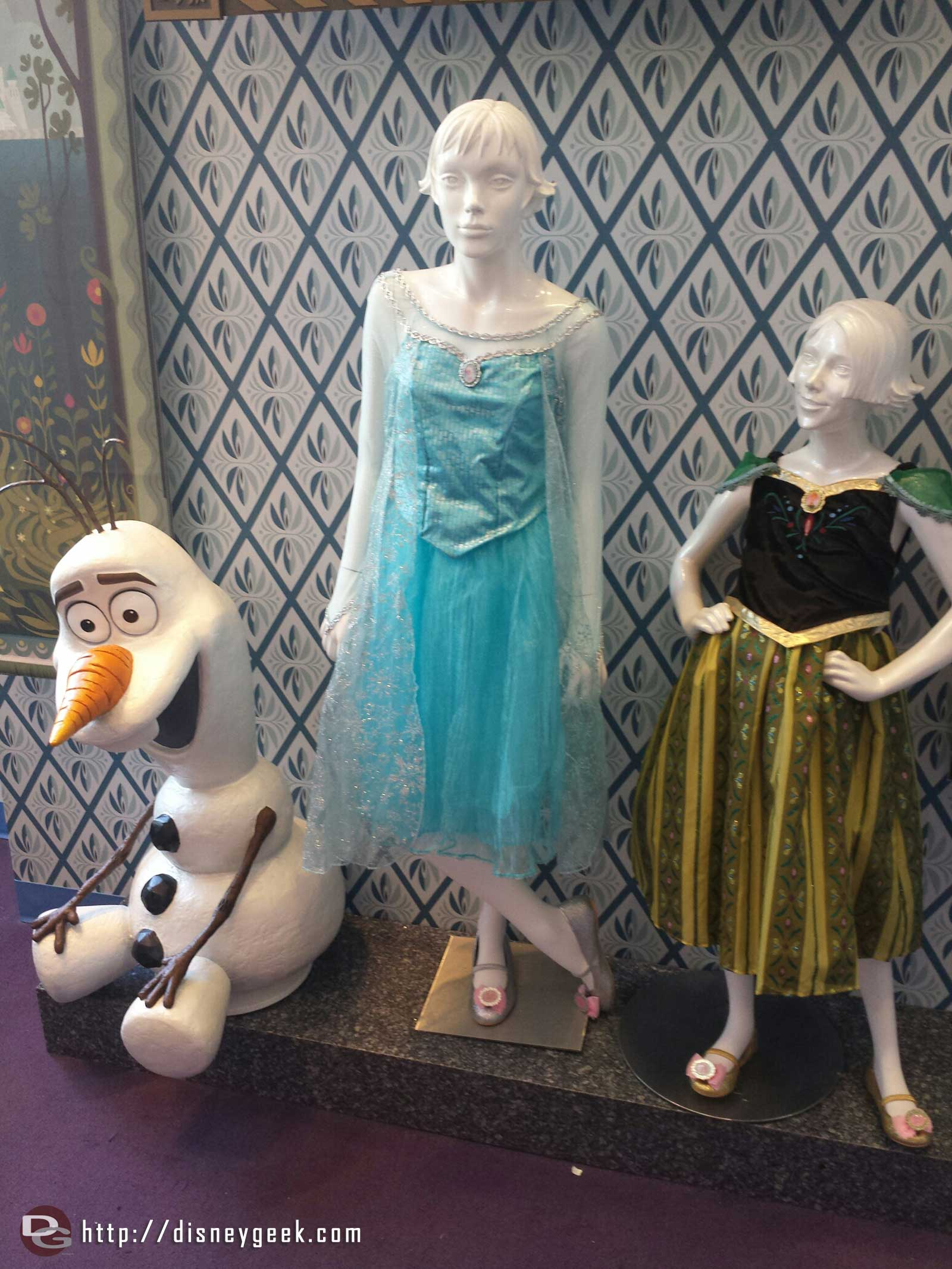 A quick look inside Anna & Elsa's Boutique at two dresses and Olaf