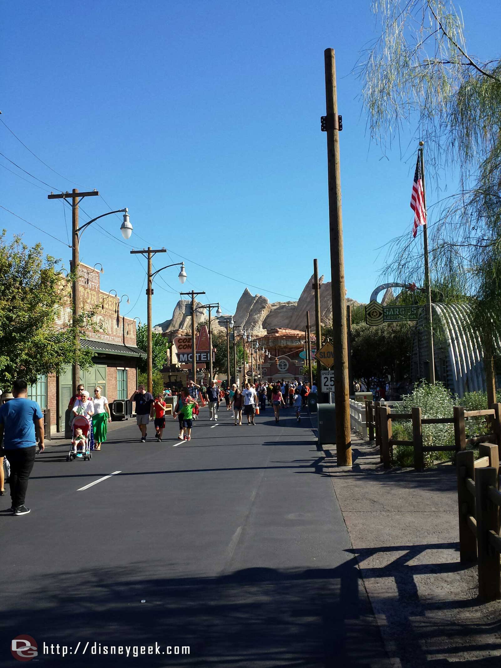 #CarsLand is preparing for Christmas the poles for the garland and lights on Route 66 are in place