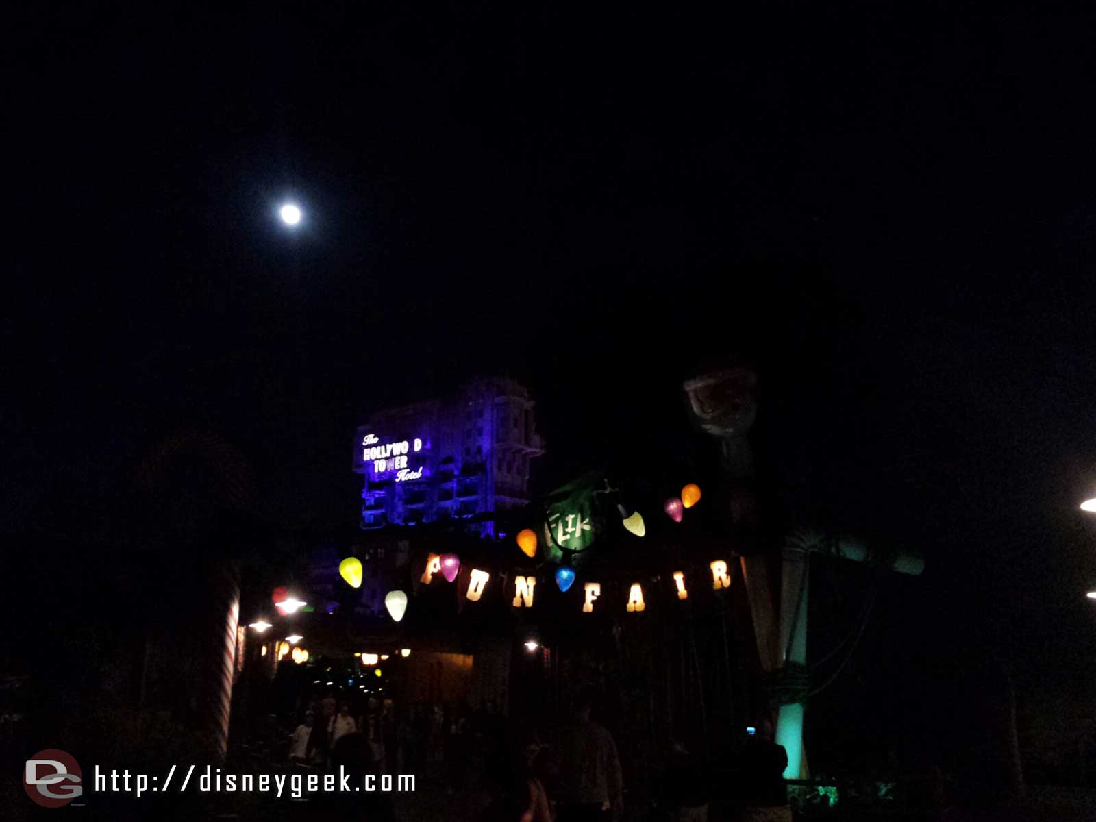 The entrance to Flik's Fun Fair with Christmas decorations and a full moon too