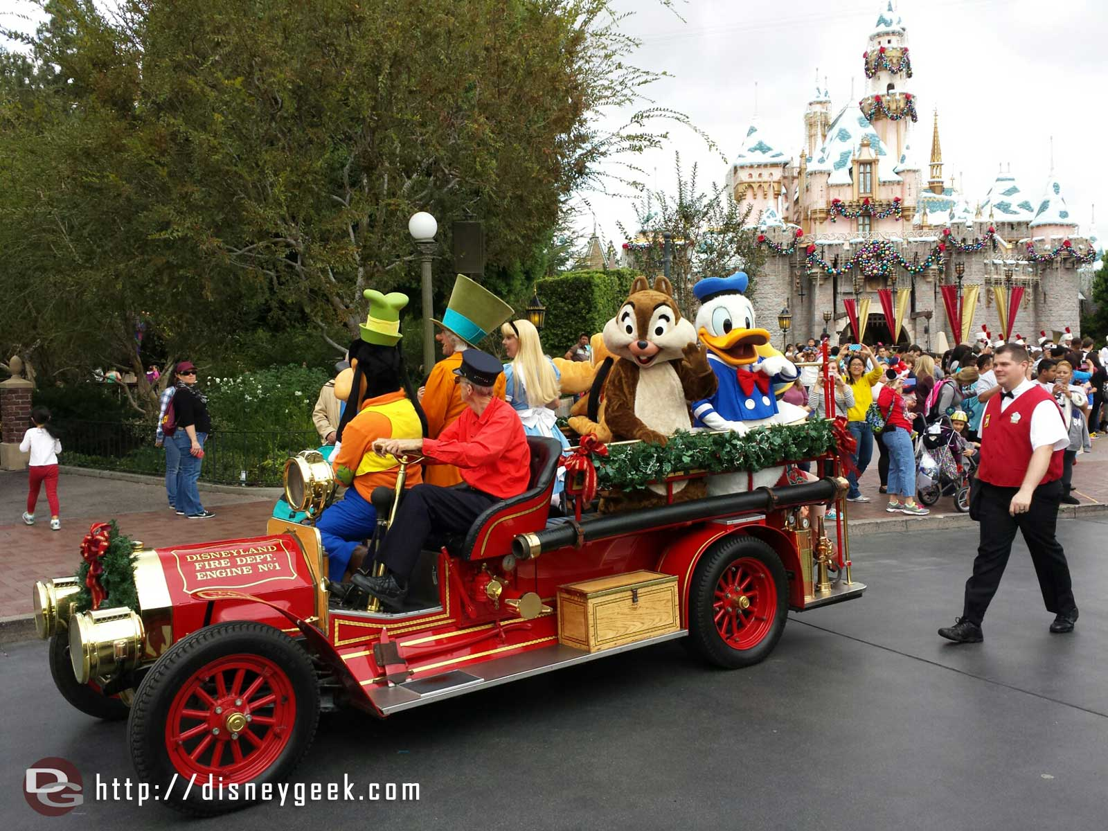 Characters taking a ride on the Main Street fire truck