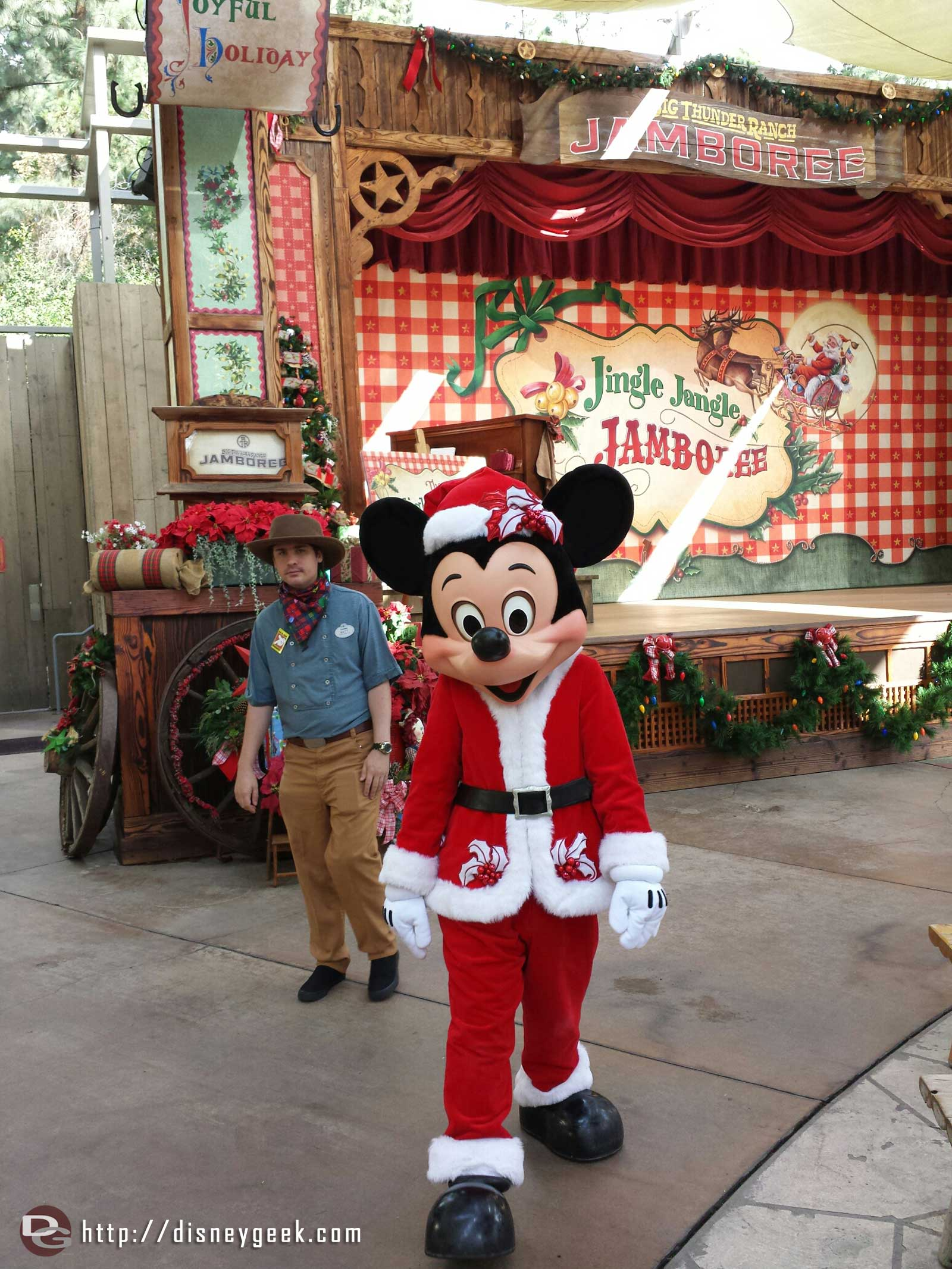 Mickey in his Christmas costume walking around the Jingle Jangle Jamboree #Disneyland