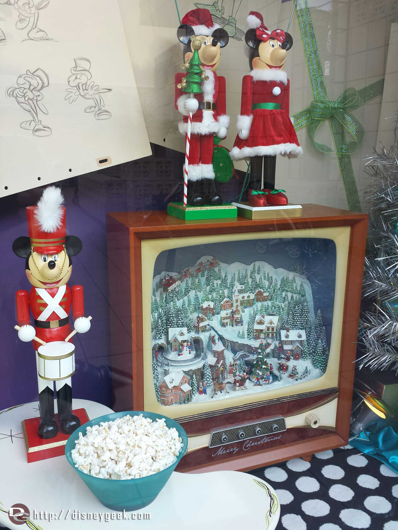 The Off the Page window featuring nutcrackers and a Christmas scene on the TV