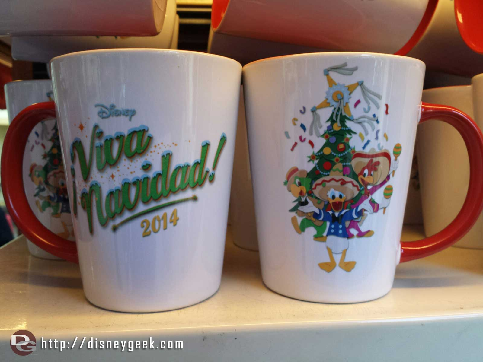 The 2014 ¡Viva Navidad! Logos on mugs in this picture