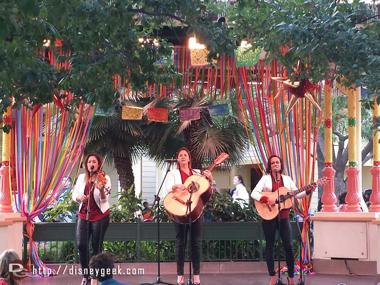 ¡Viva Navidad! Trio Ellas performing on the stage in Paradise Gardens