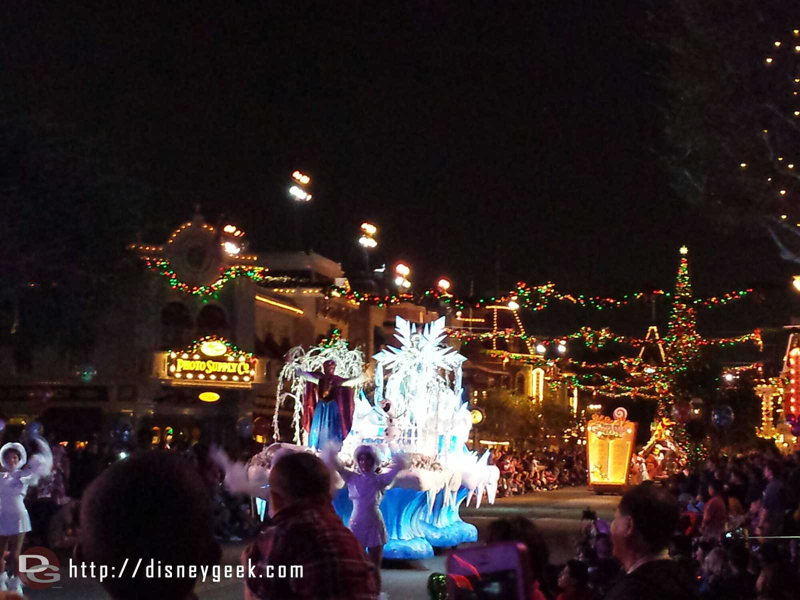 The #Frozen float moving up Main Street USA in A Christmas Fantasy Parade #Disneyland