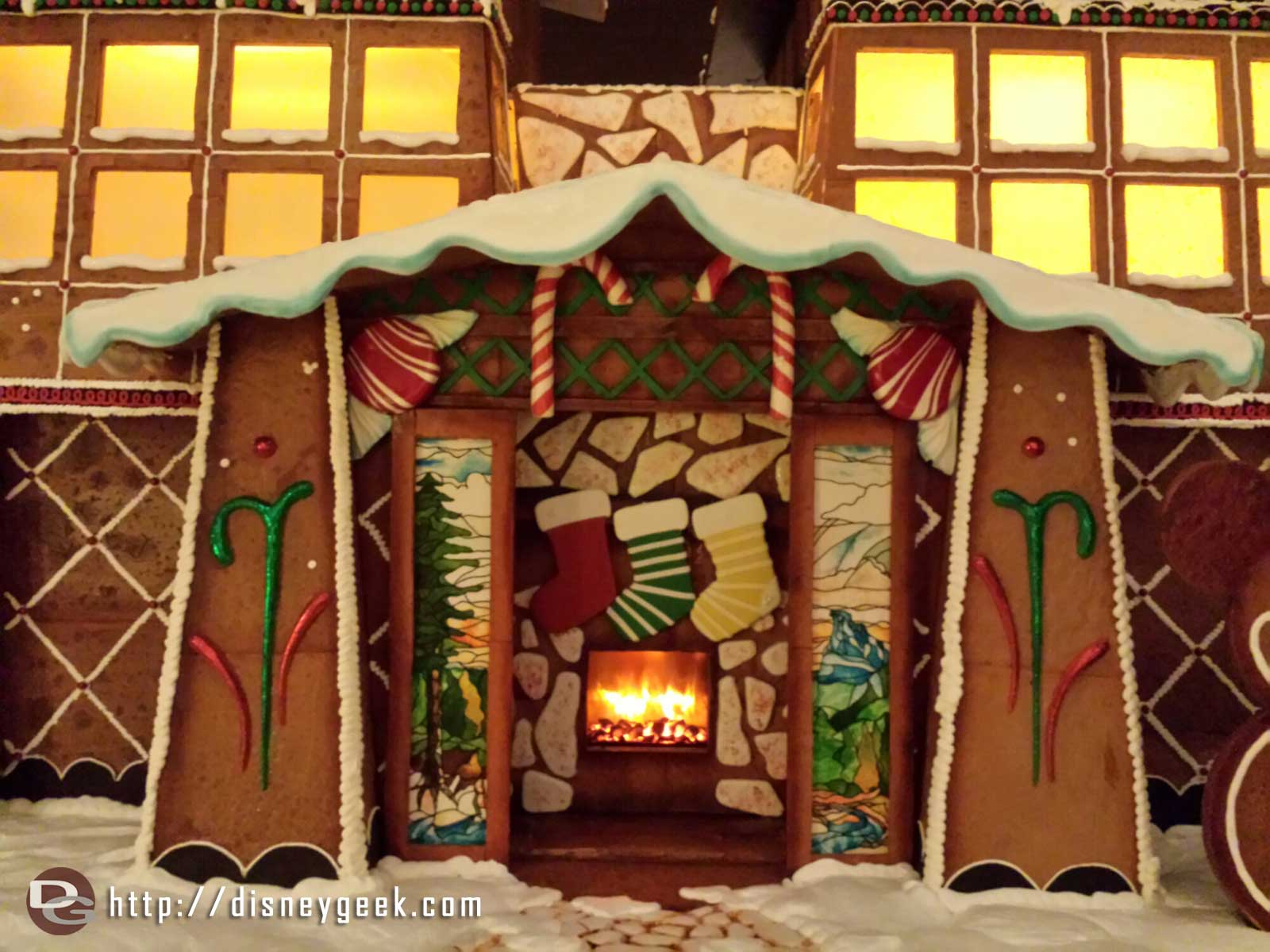 A closer look at the entrance to the gingerbread hotel in the Grand Californian lobby