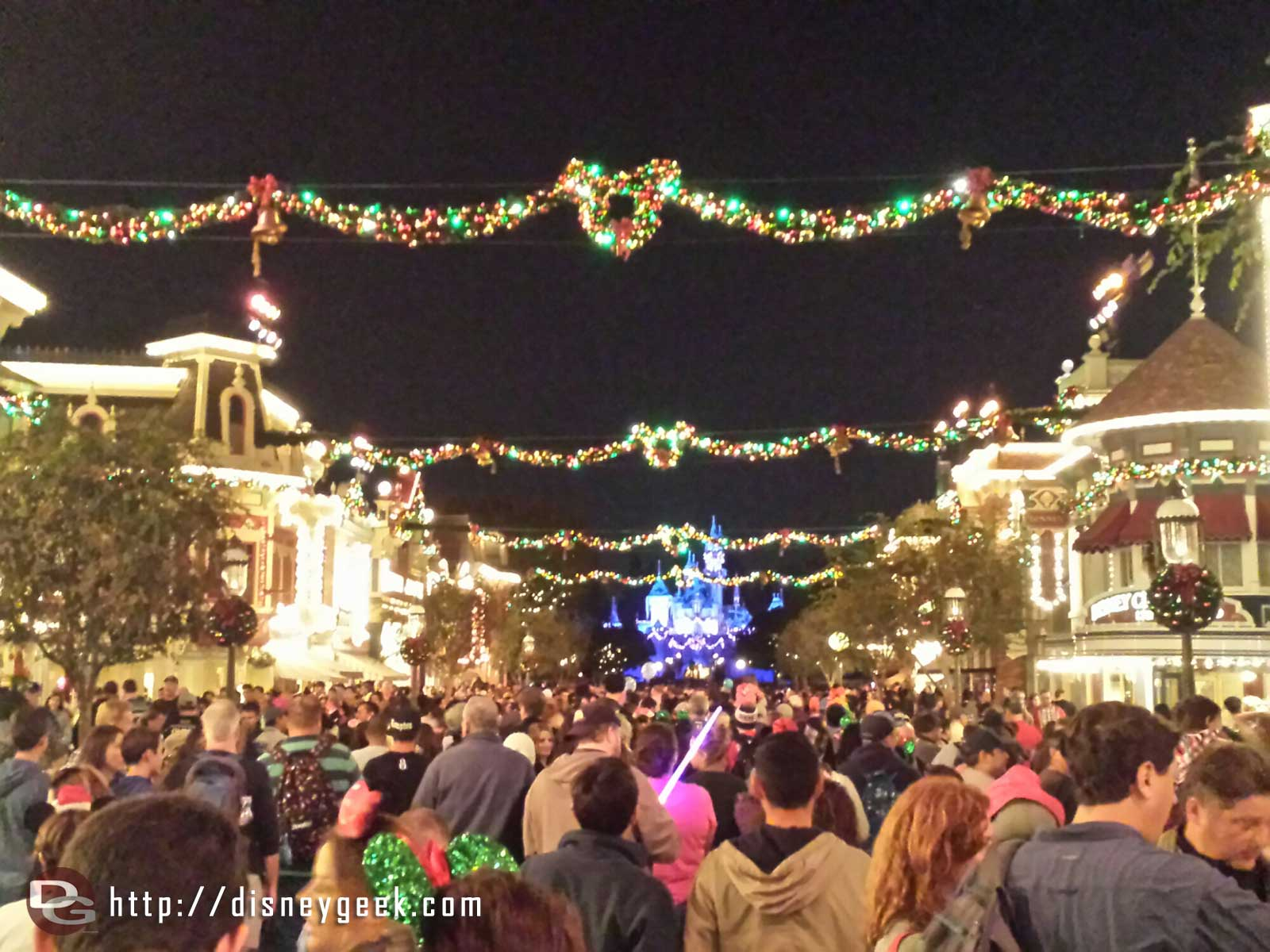 Waiting for Believe in Holiday Magic #Disneyland. They have played the high wind warning several times