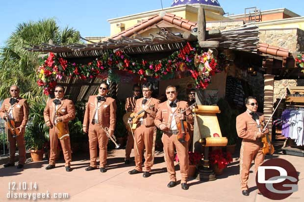 The Epcot Mariachi Cobre group provide the narration and music.