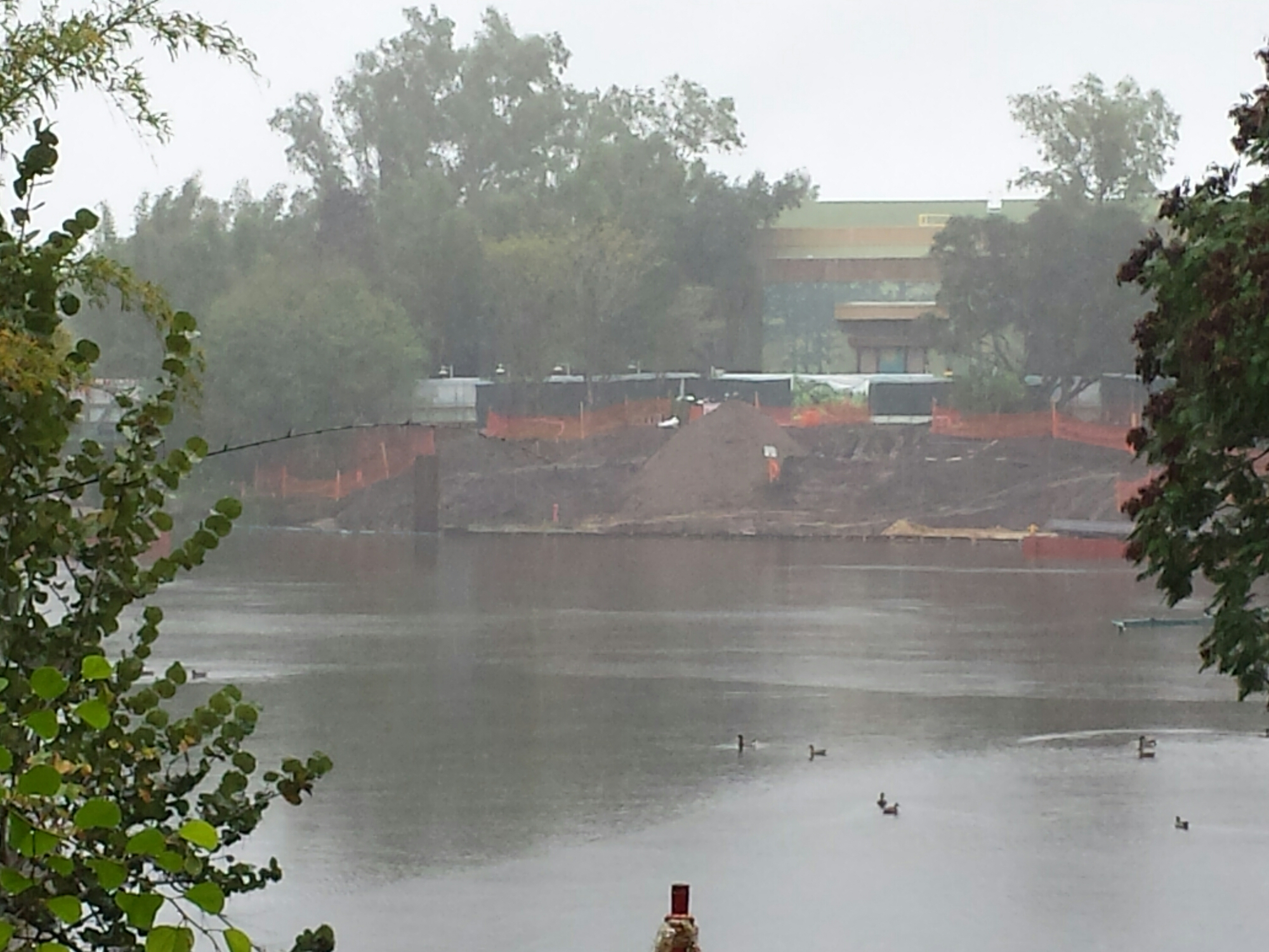 A look across a rainy lagoon at the prep work underway for the new viewing area