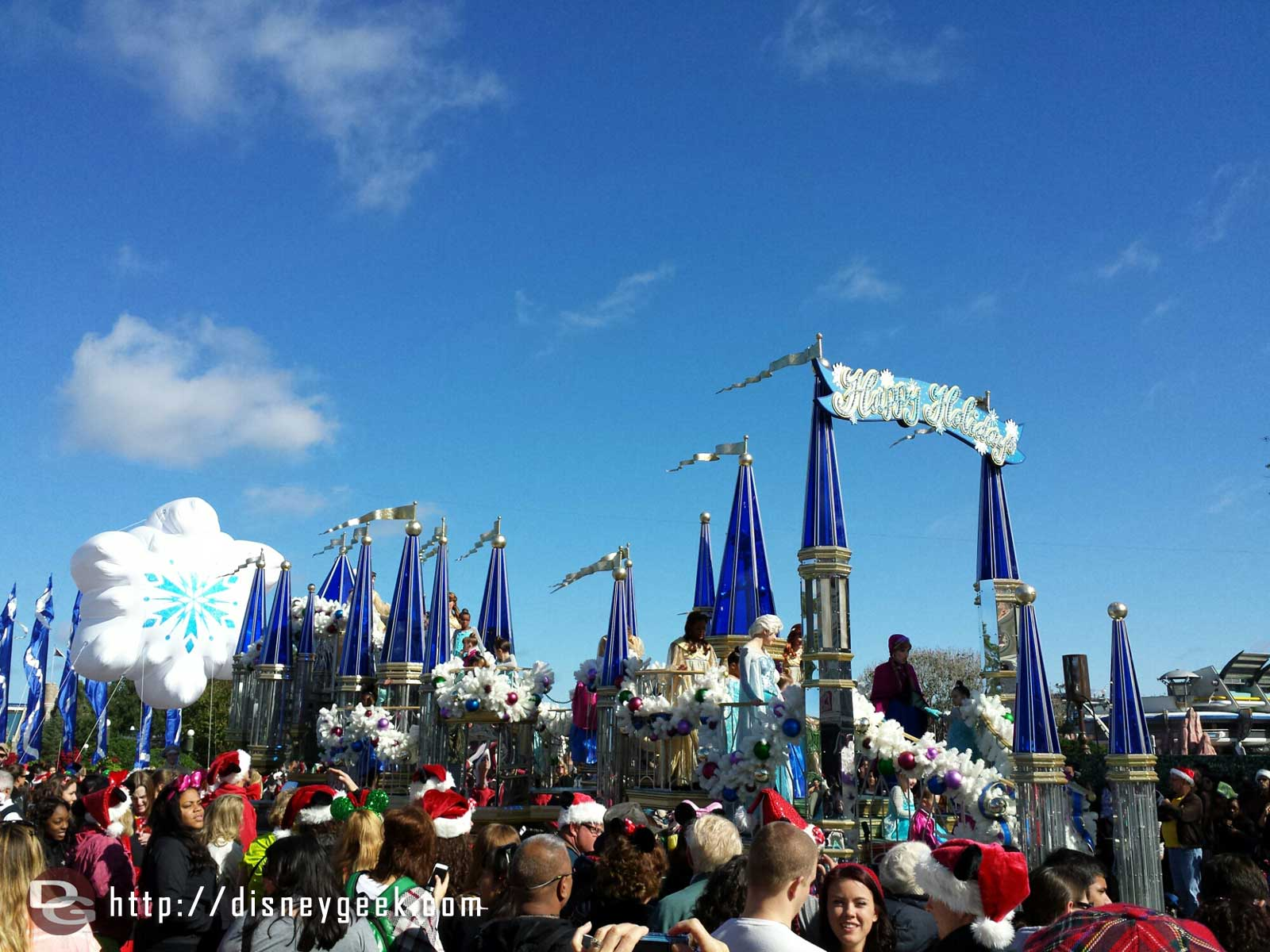 The Castle float has Anna & Elsa plus several kids in dresses for the parade #WDW #Frozen Christmas Celebration
