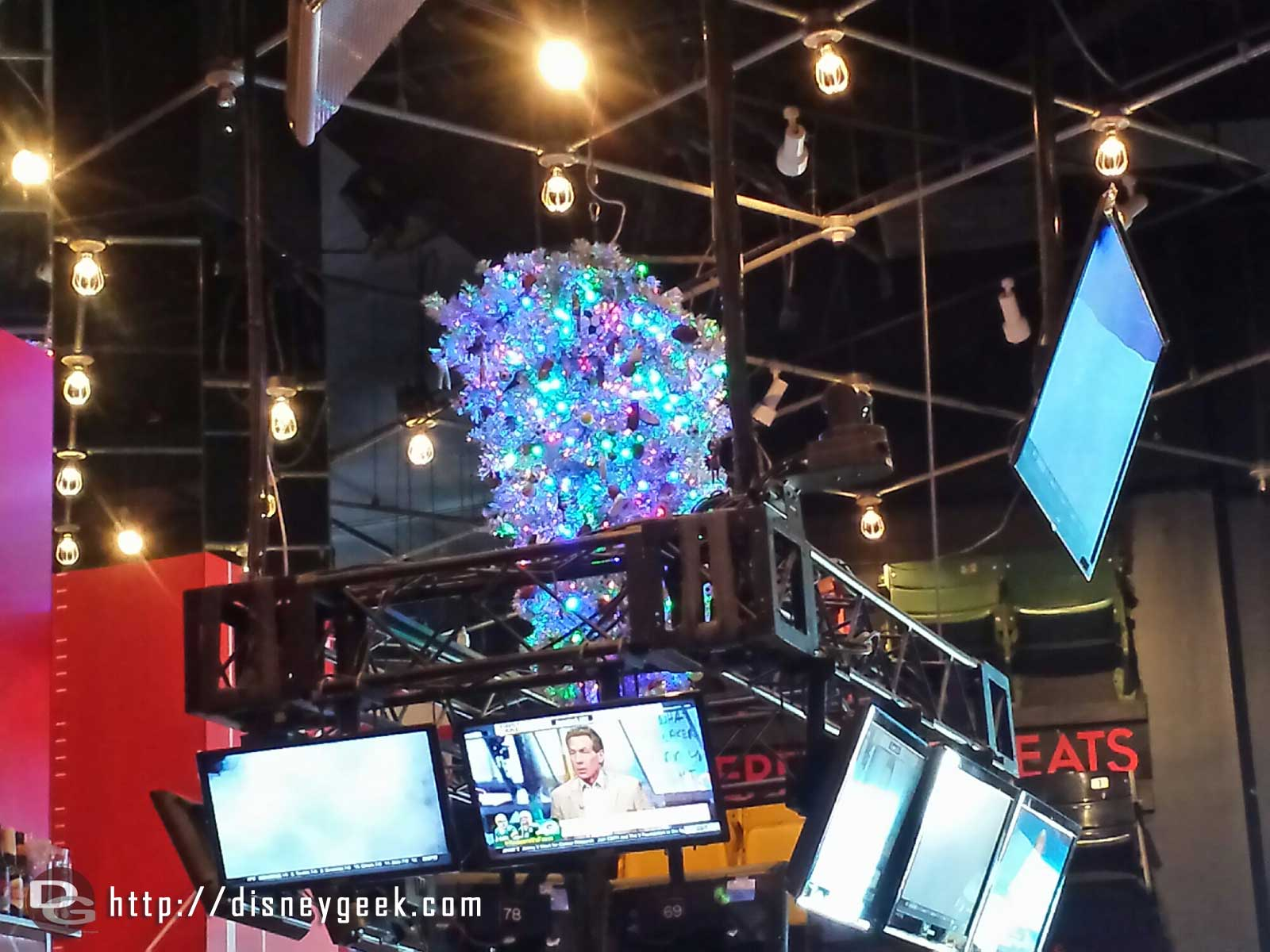 A Christmas tree hanging upside down above the bar in the ESPN Club