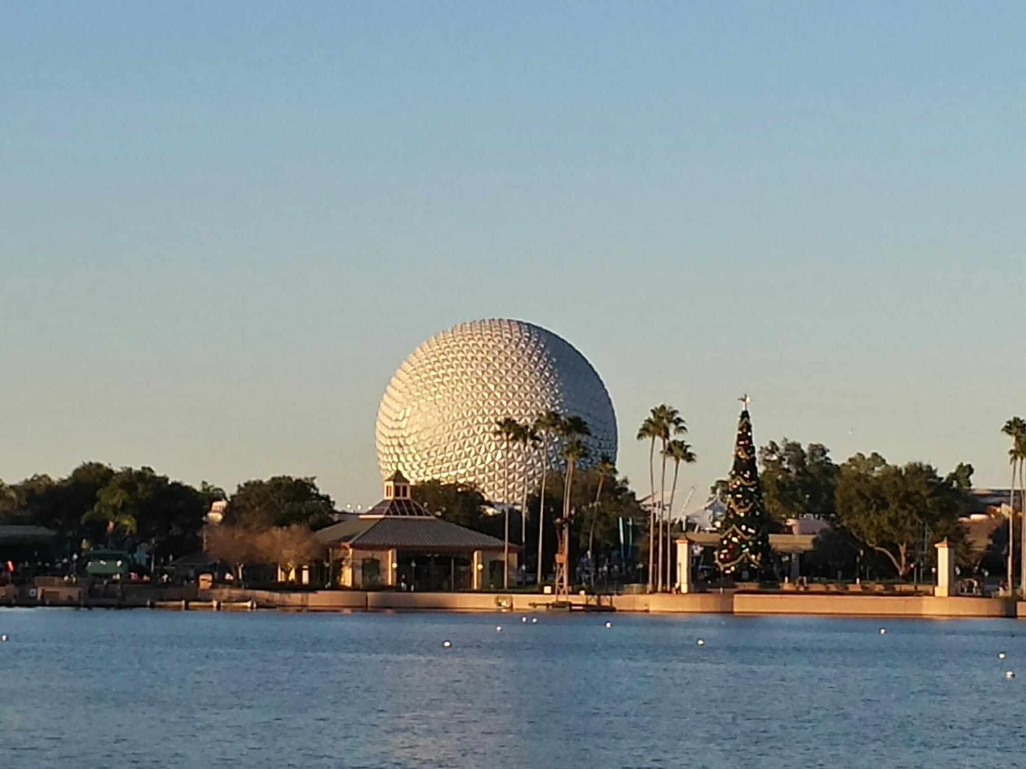 Spaceship Earth & the #Epcot Christmas tree as the sun is setting this evening