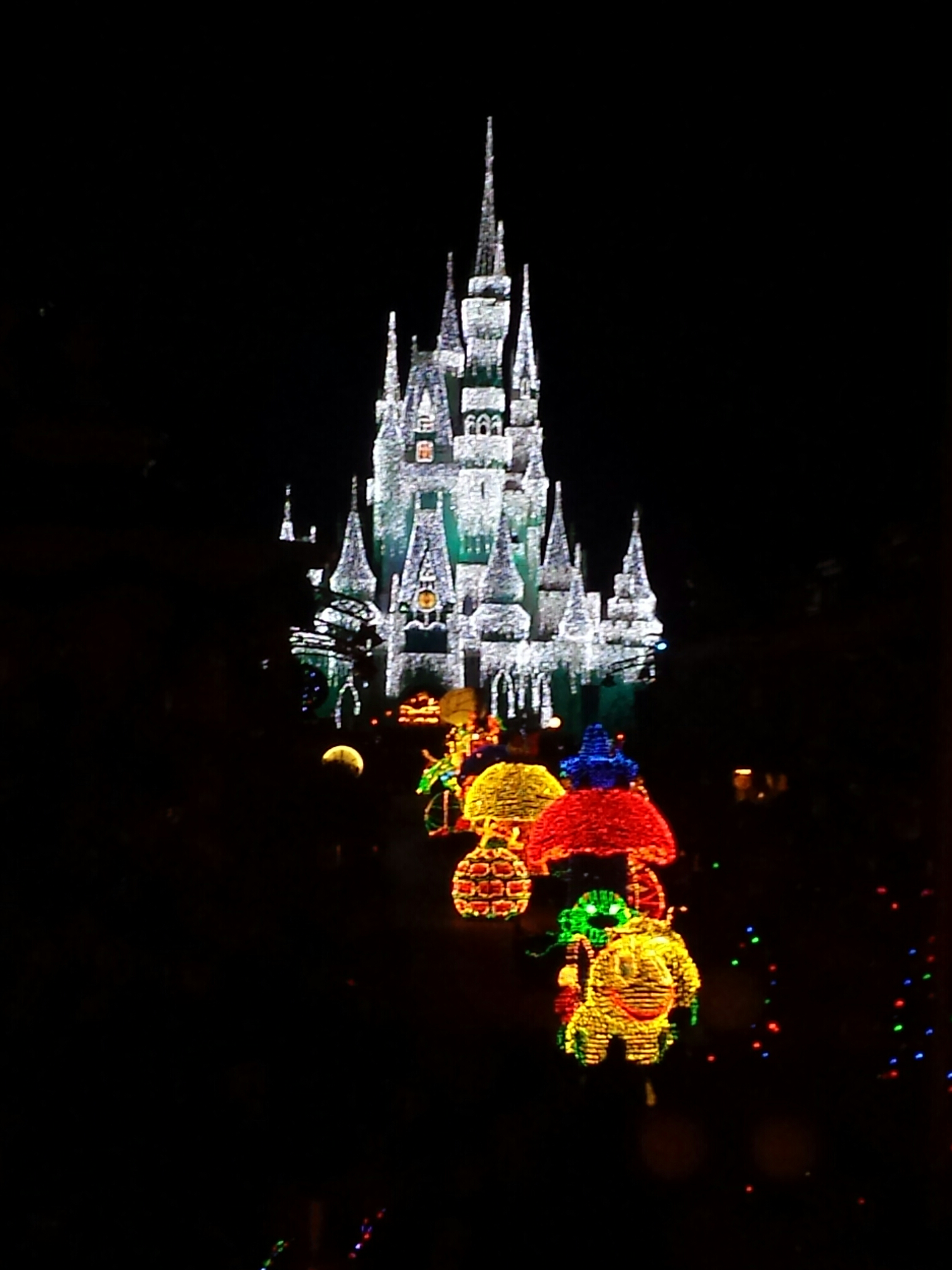 The Main Street Electrical Parade working its way up Main Street toward Cinderella Castle.