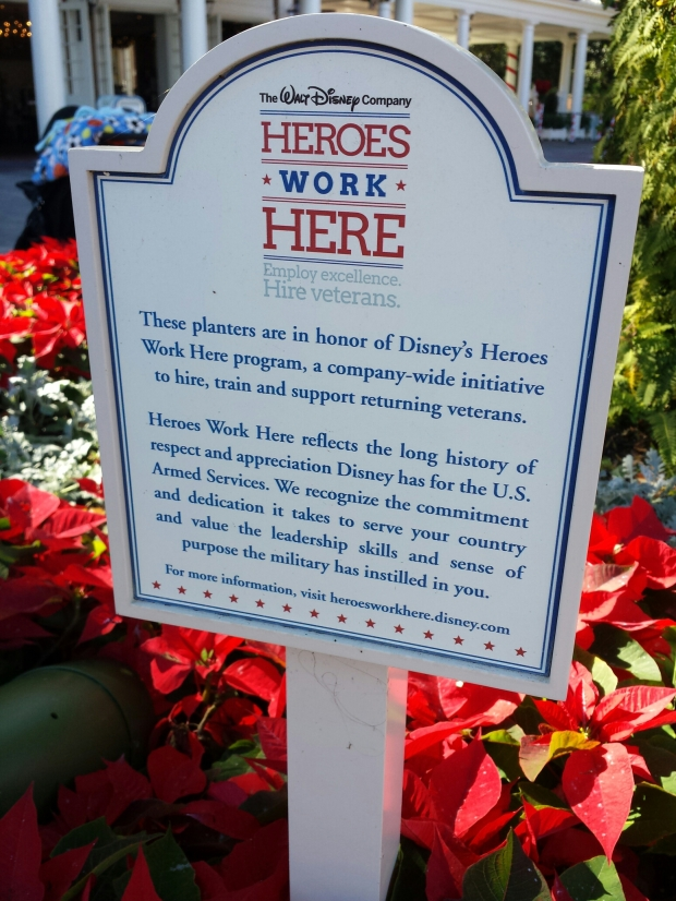 Heros Work Here sign in a planter at the American Adventure.