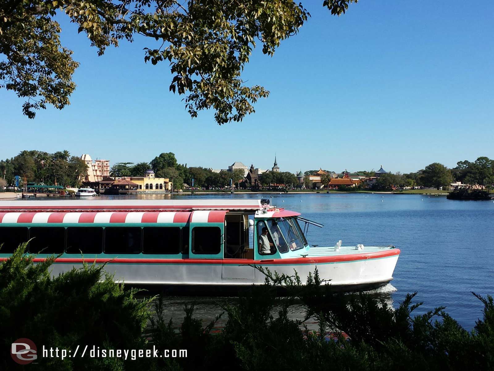 A friendship launch cruising by on World Showcase Lagoon #Epcot