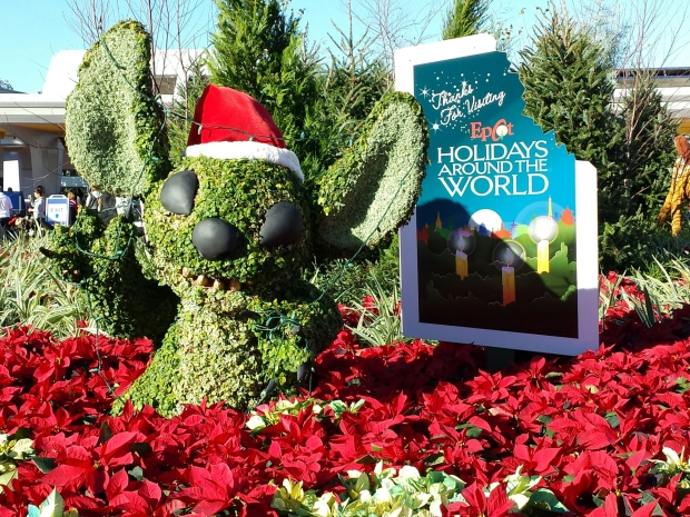 Stitch at the entrance/exit to Epcot celebrating Holidays Around the World.