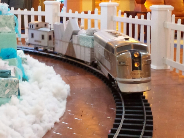 A train around the the tree in the Dolphin hotel.
