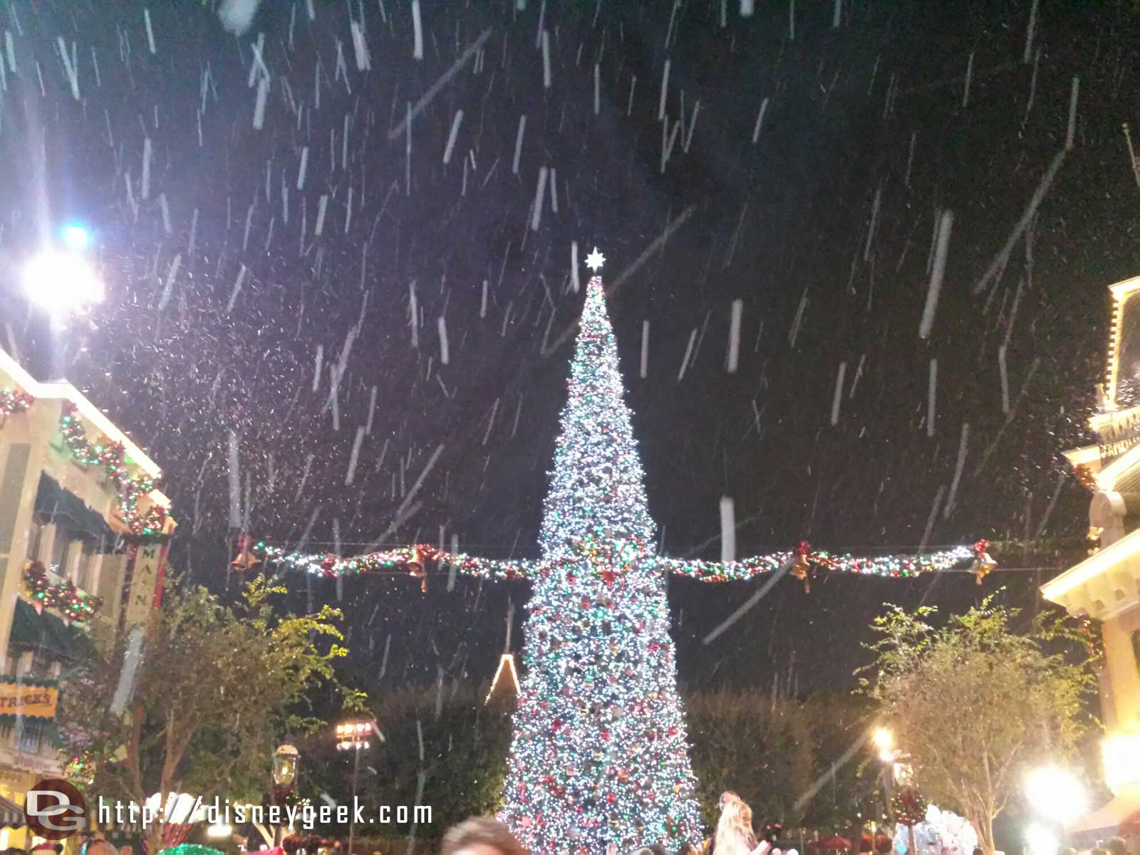 Main Street Christmas tree during snowfall #Disneyland