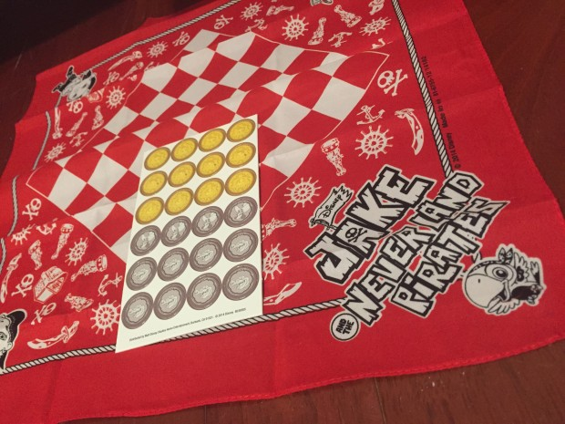 Checkboard bandana with checker playing pieces inside.