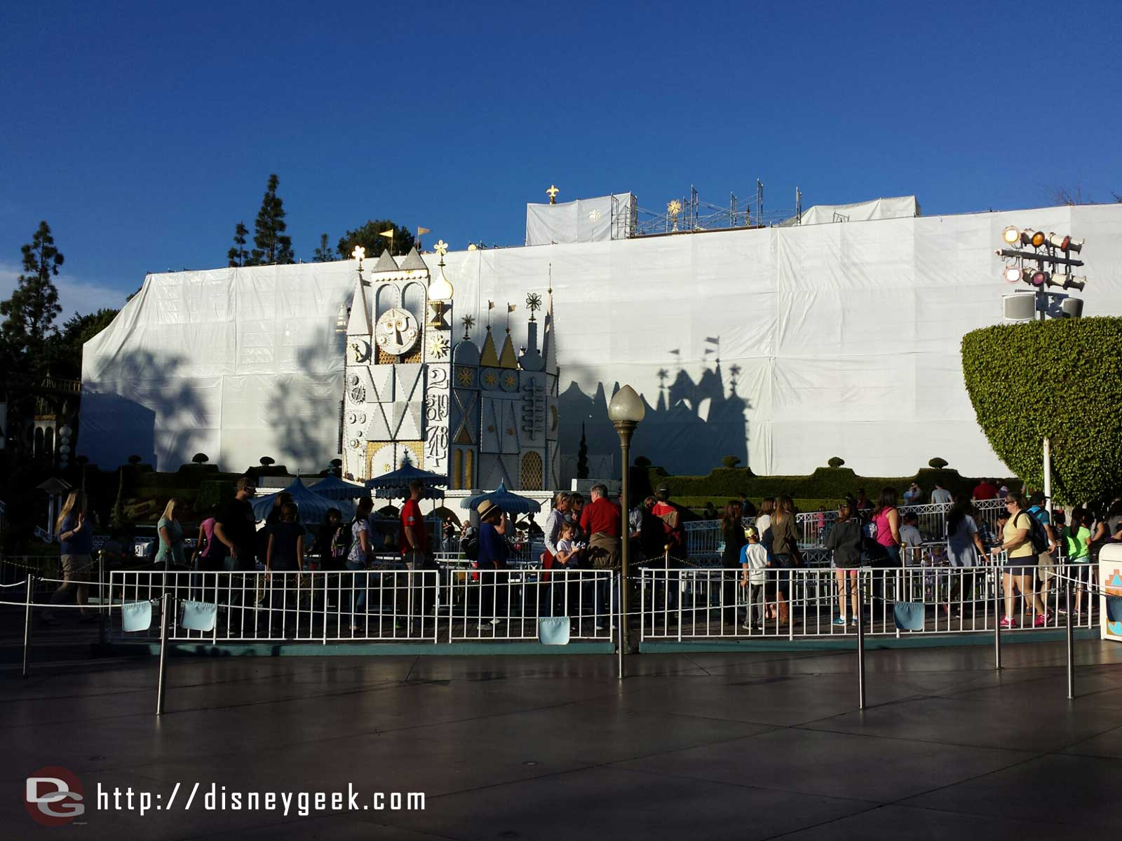 The Small World facade is under wraps for renovation but the holiday version of the attraction is still open #Disneyland