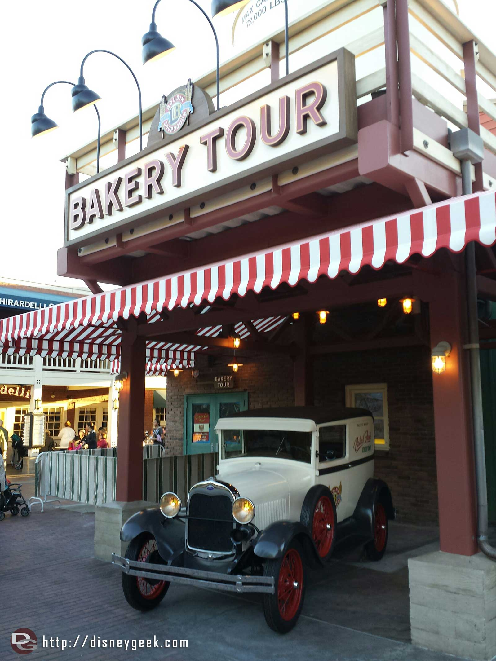 An old Ford truck parked out front of the bakery tour at DCA