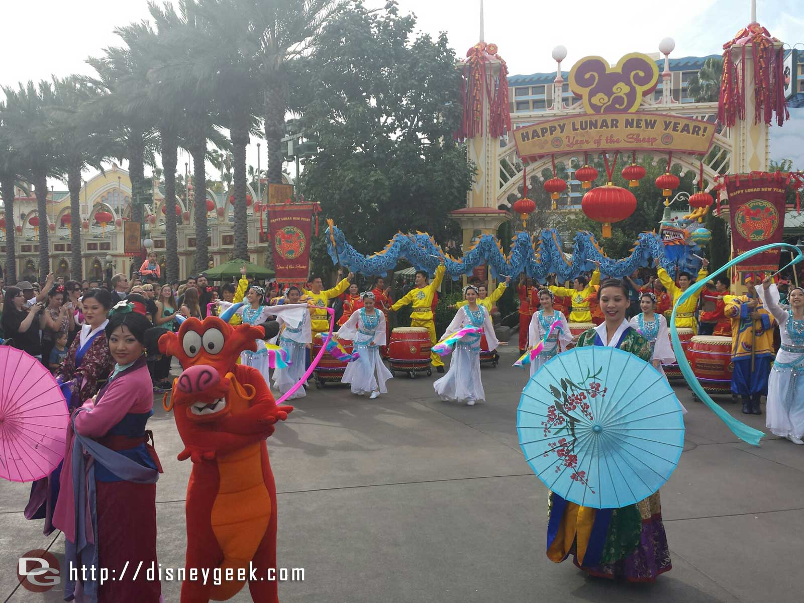 Mulan,  Mushu, other performers at the Happy Lunar New year celebration
